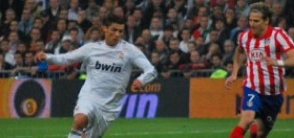 Cristiano Ronaldo y Diego Forlan.