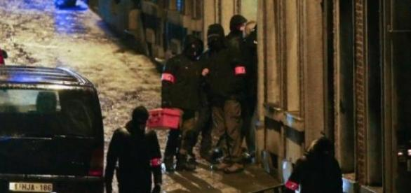 Police outside house where 2 jihadists were killed