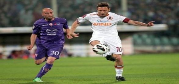 Borja Valero and Francesco Totti