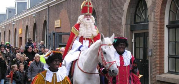 Saint Nicolas bringing gifts to the children