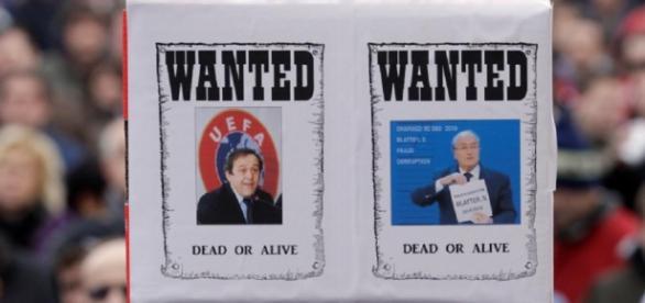 Blatter şi Platini au fost suspendaţi