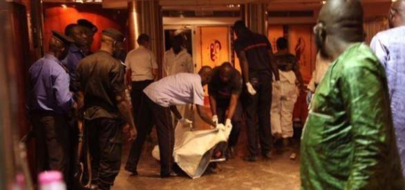 Mali security team move the body of a victim