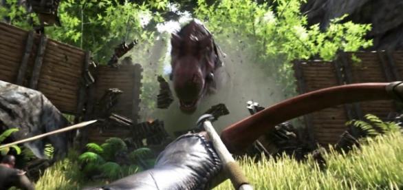 Tiranosaurio Rex atacando un poblado de jugadores.