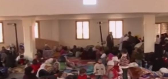 Refugiados sirios en espera de asilo.