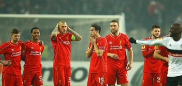 Liverpool players soak in the shock