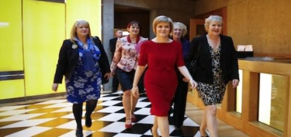 Nicola Sturgeon, the leader lady in red.