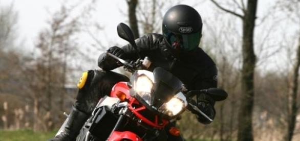 Rider atop an Aprilia sports motorcycle 1000cc