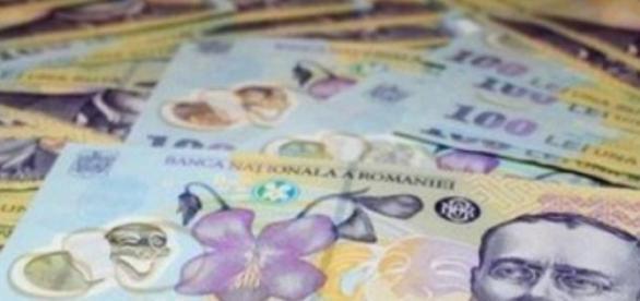 Salariile romanilor se duc pe mancare