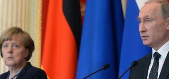 Merkel i Putin (fot. sputniknews.com)
