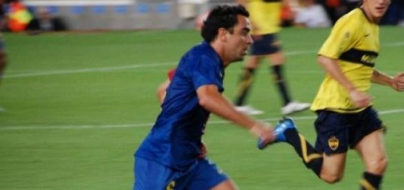 Xavi Hernández durante un partido con el Barcelona