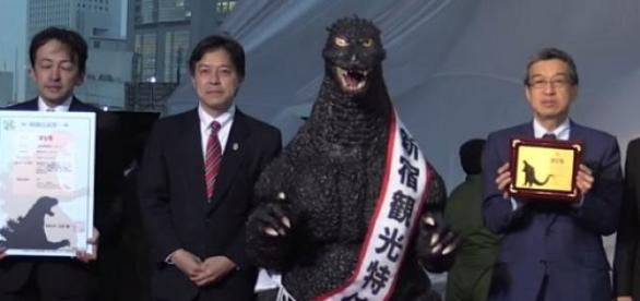 Godzilla receiving his Resident Certificate