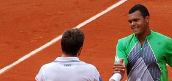 Wawrinka (left) ended Tsonga's hopes in Paris
