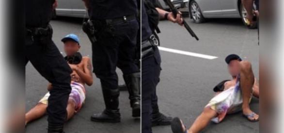 Jovem cai no chão ao receber descarga elétrica da pistola