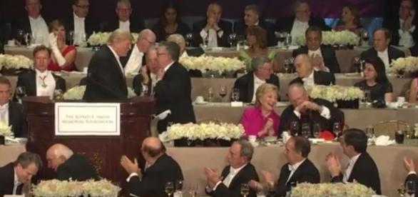 Hillary Clinton laughs it up with cardinal after Donald Trump gives awkward and embarrassing speech / photo via screenshot, CBS Network
