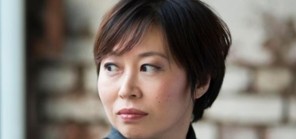 Xian Zhang: A rare chance to see the energetic maestra— fiercely serious about music —without a beaming smile. Photo courtesy of harrisonparrott.com.