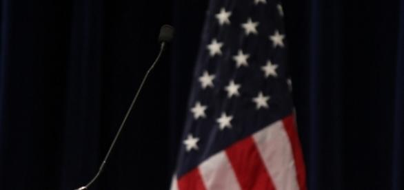 Microphone and the American flag / Photo via Evan Guest, Flickr