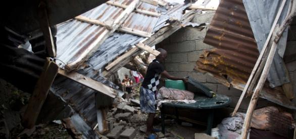 A man in Les Cayes, Haiti, picks through the ruins of his hurricane damaged home/Photo vis AP