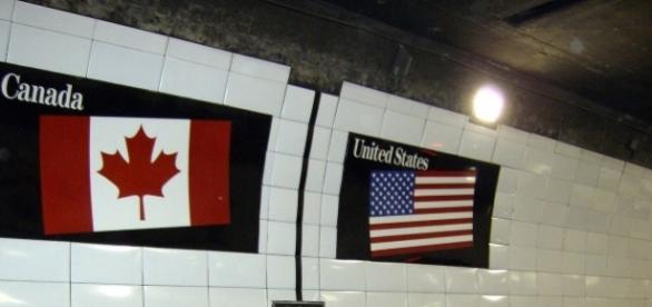 Flags in Detroit-Windsor Tunnel / Photo by Mikerussell, via Wikimedia Commons (Creative Commons Attribution-Share Alike 3.0 Unported license)