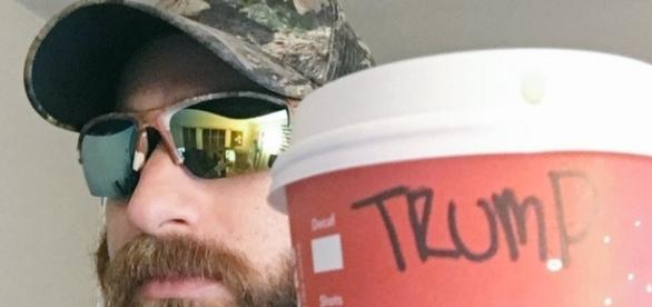 "A photo of the Twitter user Baked Alaska with his ""Trump cup"" (screencap via Twitter.com/bakedalaska)"