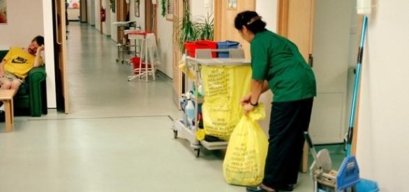 Hospital cleaner on AIDS ward at Ealing General Hospital, London ... - photoshelter.com