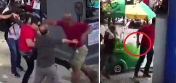 A imagem mostra o momento em que o homem de camisa vermelha saca a pistola