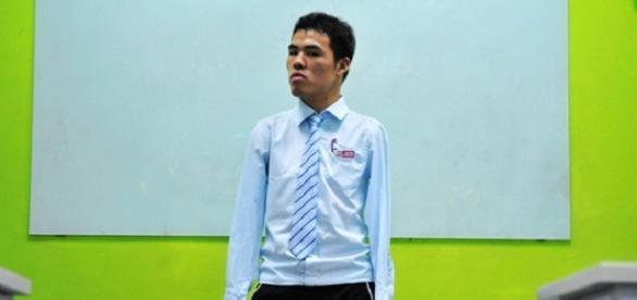 Wu Jianping perdeu os braços quando tinha 5 anos