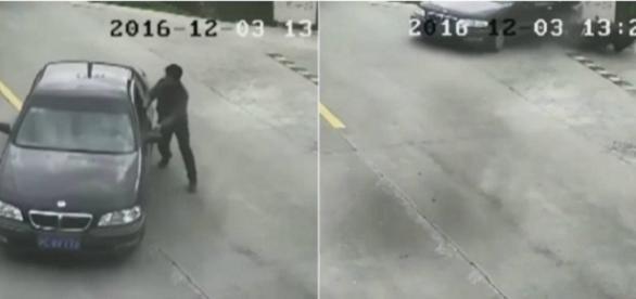 Chinês que se esqueceu de puxar freio de mão, tenta parar veículo que caiu no rio.