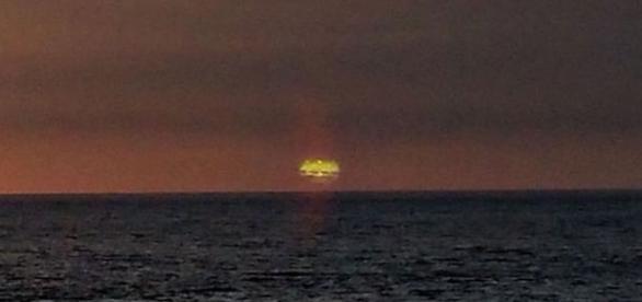 Suposto ovni apareceu nas primeiras horas da manhã, próximo ao Sol. Veja foto original na sequência (MUFON)