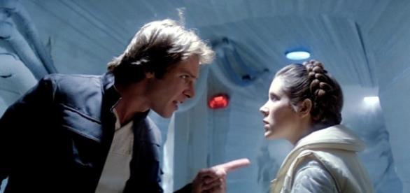 Carrie Fisher ao lado de Harrison Ford, com quem fazia par romântico na saga de George Lucas