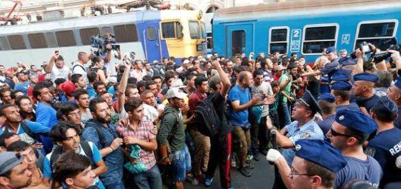 Merkel lässt sich feiern, das Flüchtlingsdesaster hält an. (Photoquelle/UrhG: Blasting.News Archiv)