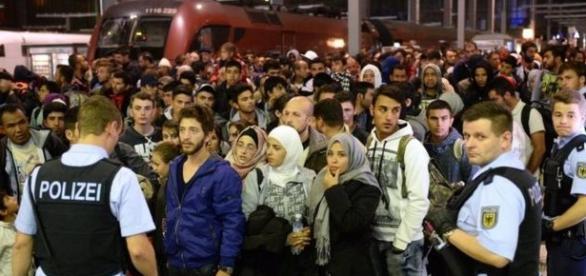 Imigranți într-o gară din Germania