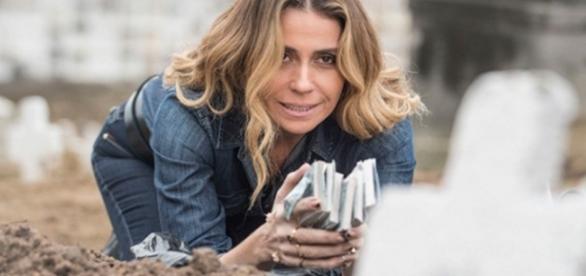 Atena desenterra dinheiro de cemitério - Foto/Divu