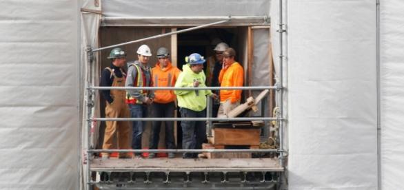 Os dois imigrantes trabalhavam na construção