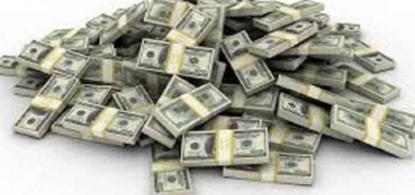 Fotogafia de un monton de fajos de dolares
