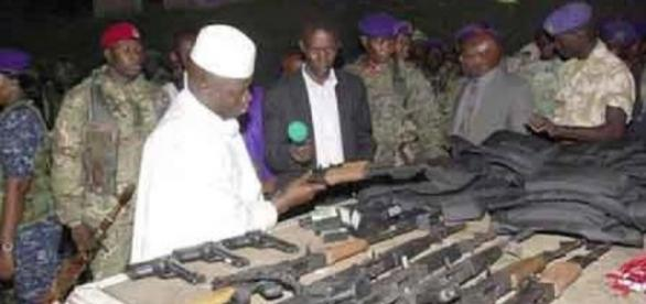 Jammeh with some of the weapons seized from the assault on his presidential compound / Photo via GRTS