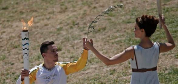 A chama olímpica fascina os atletas.