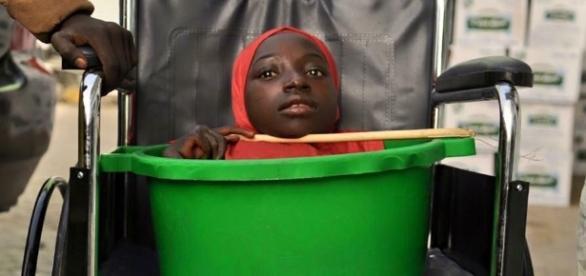 Nigeriana vive em bacia à espera de descobrir doença.