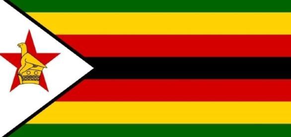 The Zimbabwe national flag / Image via public domain Wikimedia.