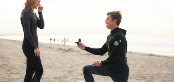 Surfing Marriage Proposal - howheasked.com