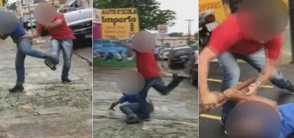 Vaga em estacionamento faz dois homens entrarem em luta corporal no meio da rua.