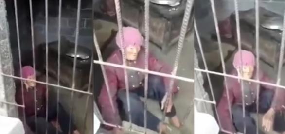 Idosa de 92 anos era mantida enjaulada pelo próprio filho, na China (foto: Reprodução/YouTube)