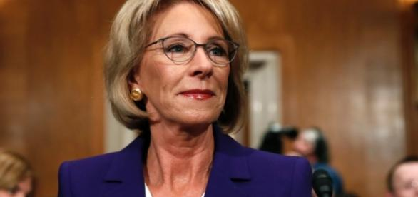 Betsy DeVos pick pushes vouchers, parries questions over ethics ... - cnn.com