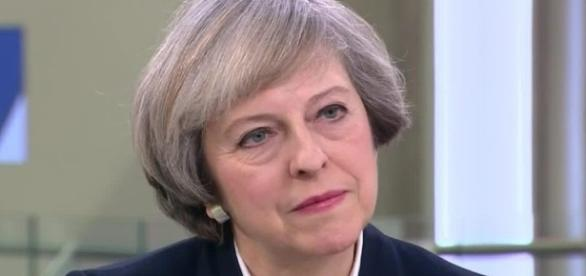 Theresa May gives icy glare as she condemns Donald Trump's ... - thesun.co.uk