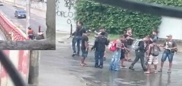 Criminosos armados desfilam em frente à Marinha no Rio de Janeiro.