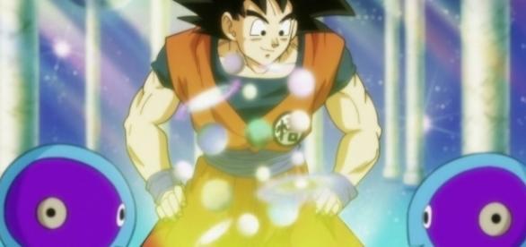 Gokú pidiendo a los Zeno sama la organización del torneo de los 12 universos