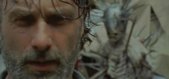 Rick inside the pit at the Junkyard getting ready to fight the spiked walker. Image Credit: AMC
