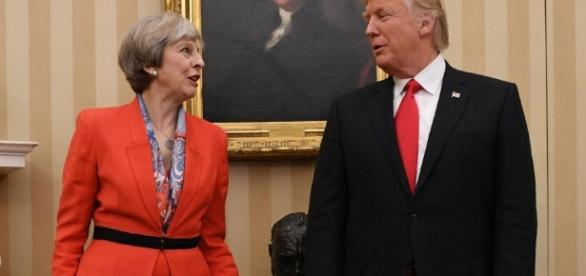 Theresa May 'very happy' to invite Donald Trump and rejects calls ... - thesun.co.uk