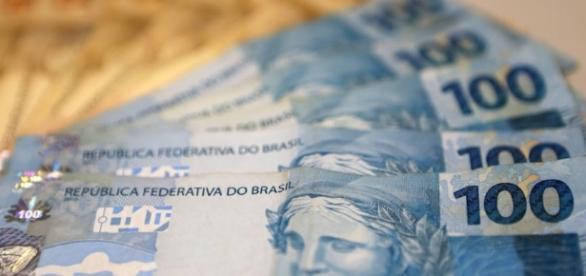 Milheres de pessoas receberão um salário sem trabalhar - Estadao.com.br - com.br