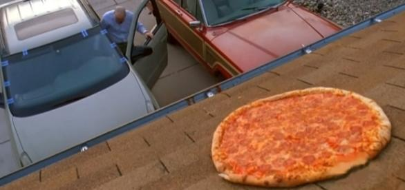 """Fans are of the pizza scene from """"Breaking Bad"""" are recreating the scene making the new home owner mad. [Image credit: andrassy227/YouTube]"""