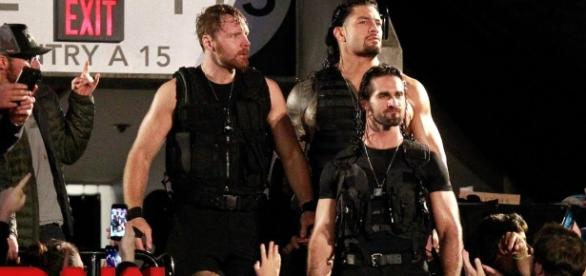 The Shield arrives through the crowd at the start of the Monday, October 16th WWE 'Raw' episode. [Image Credit: WWE/Youtube]